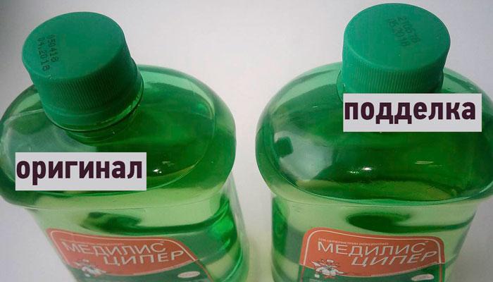 """Различие маркировок на флаконах 0.5 л оригинального и поддельного средства """"Медилис Ципер"""""""